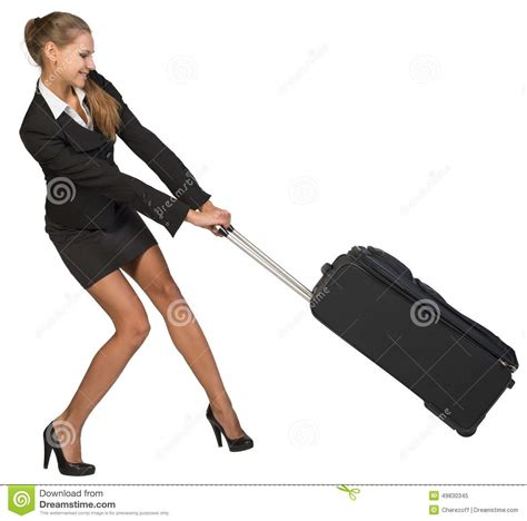 dragging but businesswoman dragging heavy wheeled suitcase at stock image image 49830345