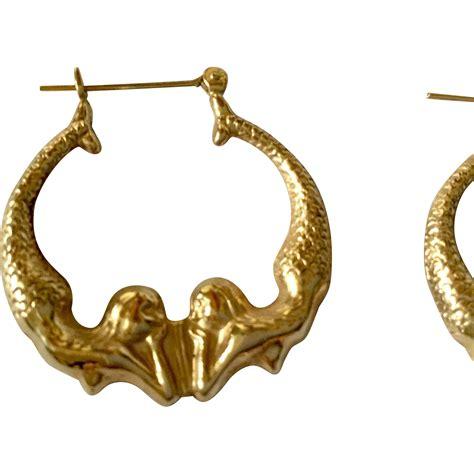 Mermaid Earring 14kt yellow gold hoop mermaid earrings from lebling on