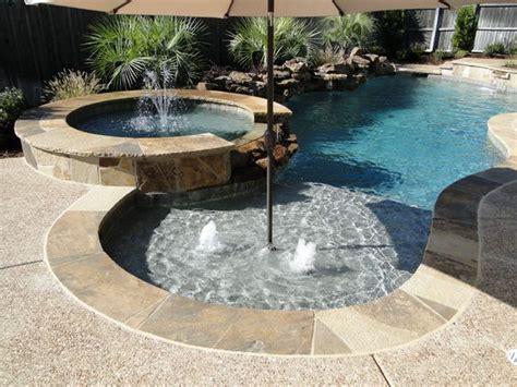 tanning backyard tanning ledge gusher fountains raised spa backyard landscaping ideas swimming pool