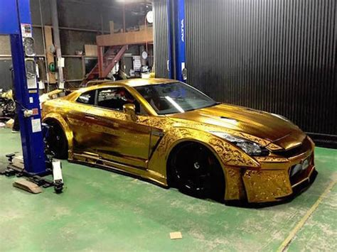 the paint on this gold car is absolutely 25 pics