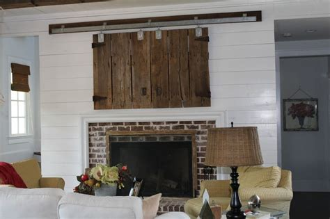 Barn Door Tv Cover Reclaimed Barn Doors Used To Conceal Tv Fireplace Track From Tractor Supply Livingroom