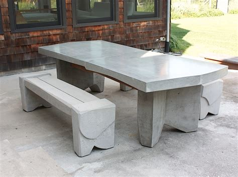 concrete dining table by sculptor nico yektai