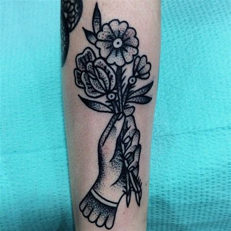 tattoo hand holding flower 1000 images about tattoos on pinterest back tattoos