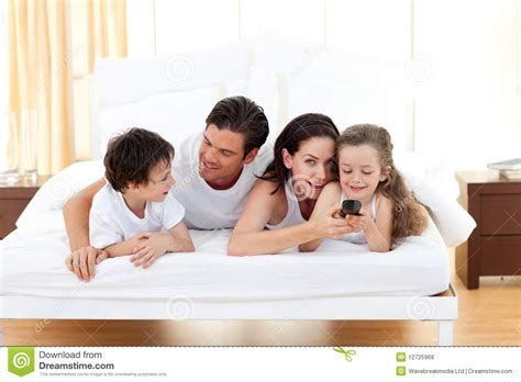 fun in the bedroom happy family having fun in the bedroom royalty free stock