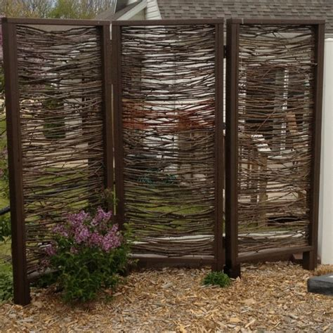 outdoor privacy screen installed made with branches by my husband for the home