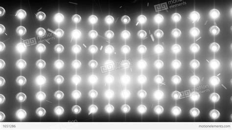 bright white lights bright flood lights background with particles and stock