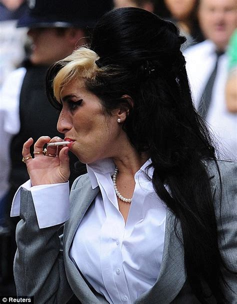Not Winehouse Smokin by Winehouse Arrives For Day Two Of Assault Trial Daily