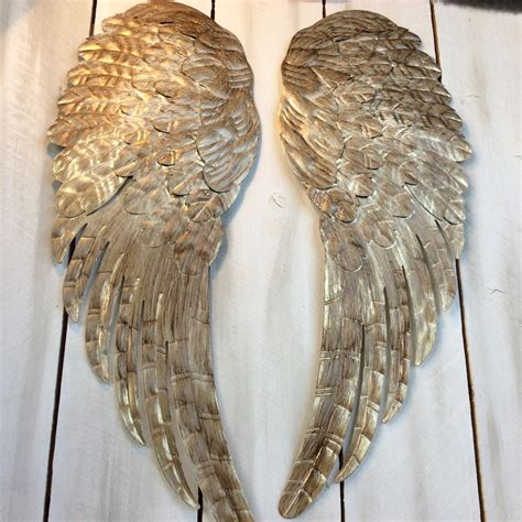Wall Decor Wings by Large Metal Wings Wall Decor Distressed Gold Ivory