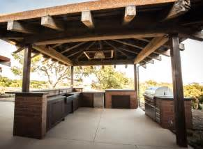 Rustic Outdoor Kitchen Designs made from reclaimed wormy chestnut custom made steel handles this