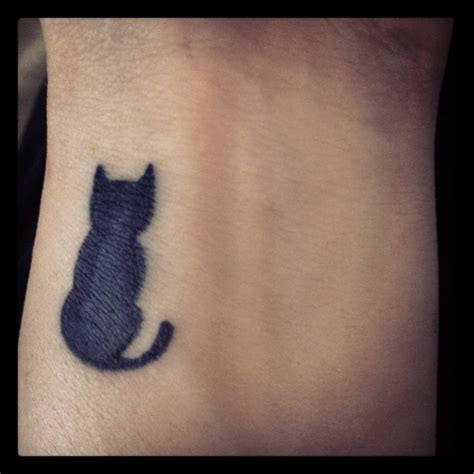 cat wrist tattoo black cat on wrist