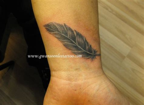 feather tattoo cost feather tattoo on wristgwan soon lee tattoo