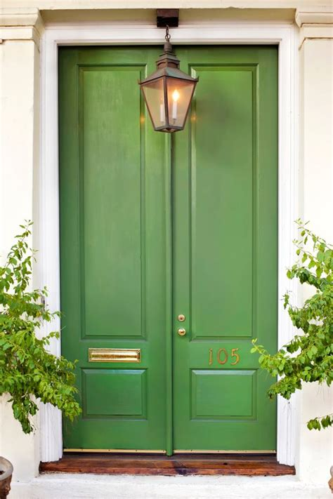 green front door kelly green door with brass hardware interiors