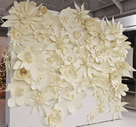 wedding backdrop white paper flowers pinned on the