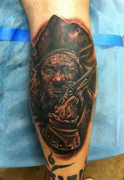 pirate face tattoo ink gun pirate on leg tattooimages biz