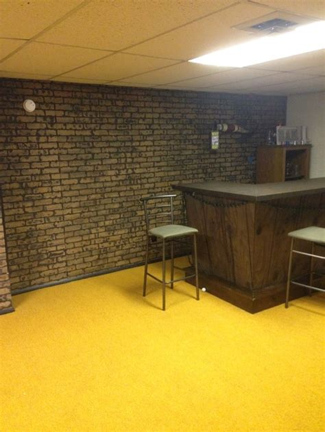 poured basement painted to look like brick basement what to do with the basement walls brick paneling