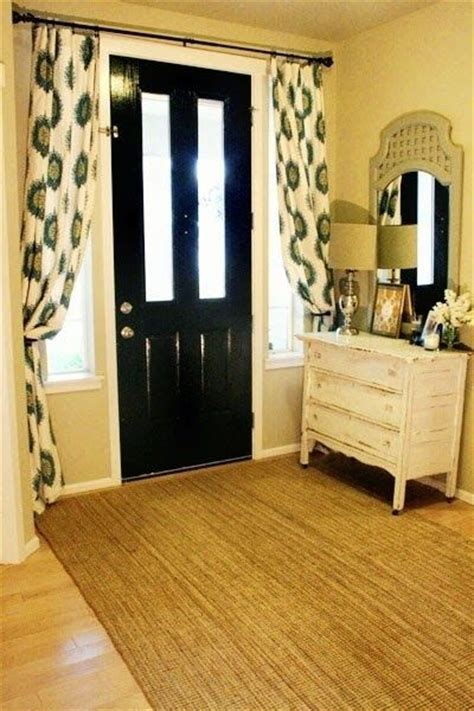 curtains over doors curtain rod over door downstairs man cave pinterest