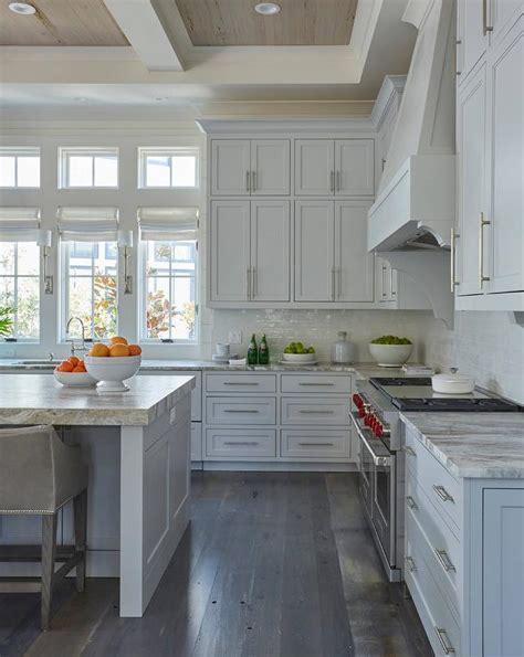 rustic grey kitchen cabinets row of windows over kitchen cottage kitchen