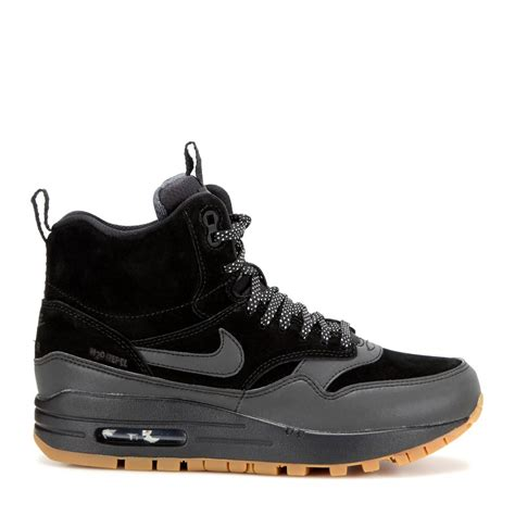 nike air boots sneakers lyst nike air max 1 mid sneaker boots in black