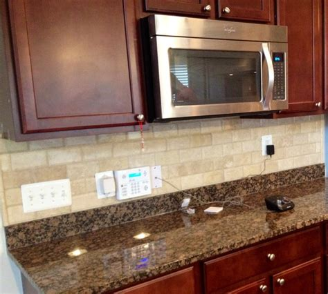 beveled travertine subway tile backsplash