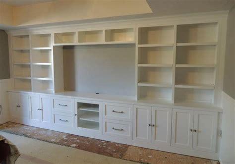 white built in cabinets built in white entertainment center media center