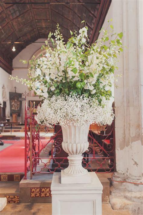 large urn arrangement  gypsophila  delphinium inspirations ceremony decor pinterest