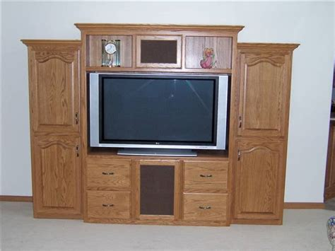automate around your windows with tv lifts and more nexus 21 entertainment centers tv cabinets book shelves
