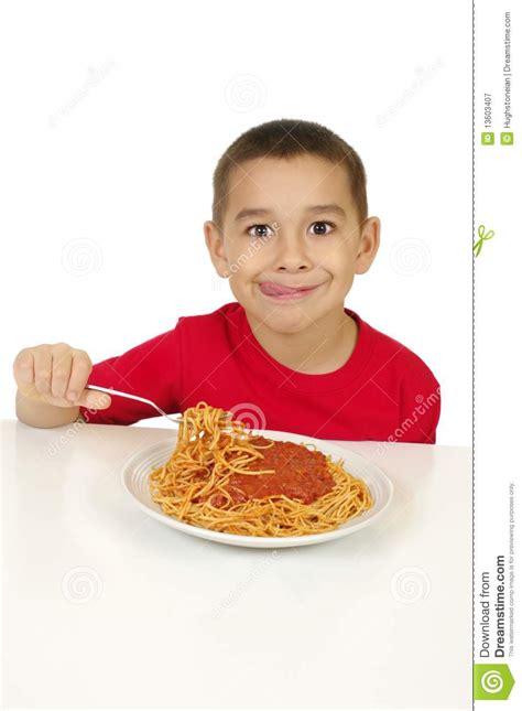 kid eating spaghetti royalty  stock photography image