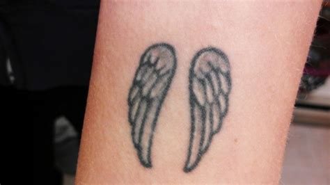 guardian angel wrist tattoos top 25 best small wing tattoos ideas on