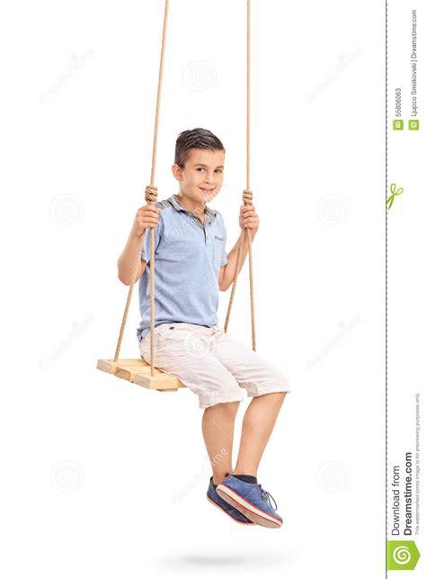 sitting swing joyful little kid sitting on a swing stock photo image