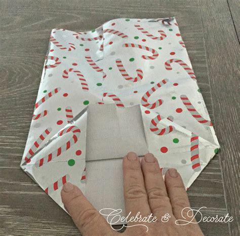 make a gift bag out of wrapping paper celebrate decorate