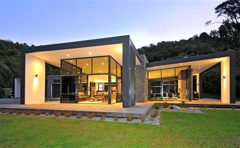 glass front house 3 glass cubed volumes sheltered under roof define