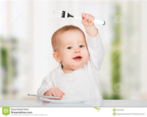 Kitchen Program Design Free funny baby with a knife and fork eating food royalty free