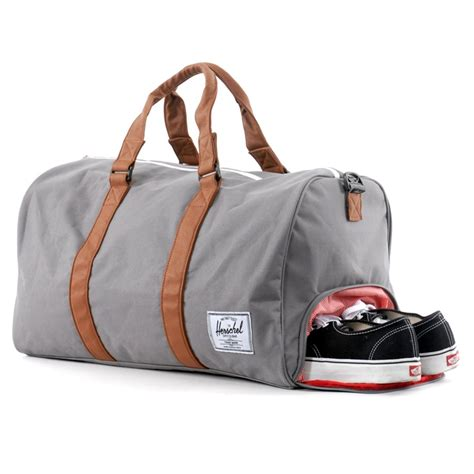 bag with sneaker compartment herschel novel duffle bag side zippered shoe compartment