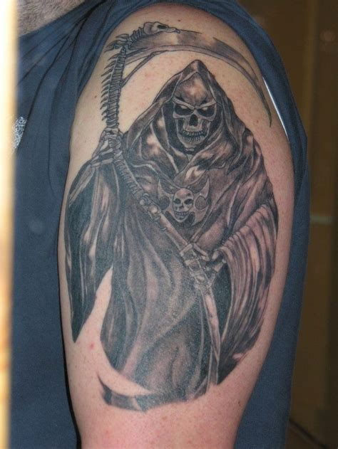 amulet tattoo grim reaper with amulet on shoulder tattooimages biz