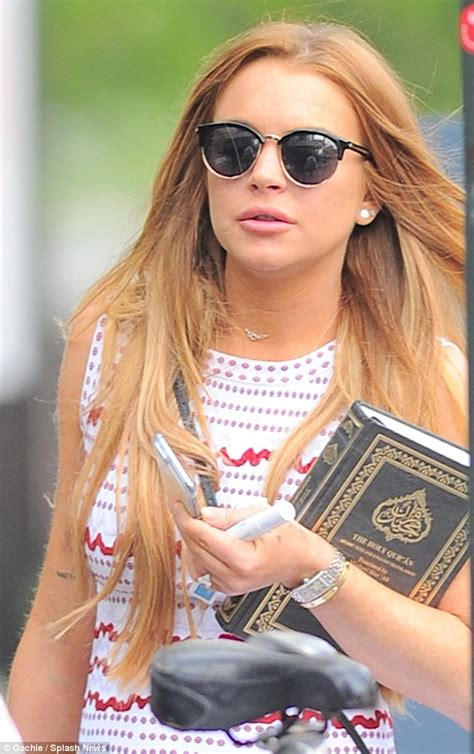 Lindsay Lohan Is Religious And lindsay lohan carries quran as she steps out in