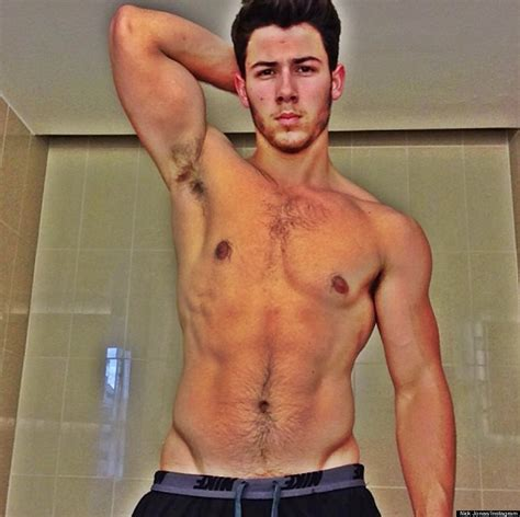 nick jonas shows off his abs in shirtless selfie on