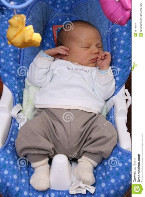 baby sleeping in swing newborn baby sleeping in baby swing royalty free stock