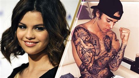 how many tattoos does justin bieber have total selena gomez reacts to justin bieber s covered