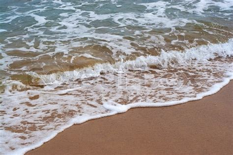 the sea close by closeup detail of the foaming sea waves washing ashore at the beach stock photo colourbox