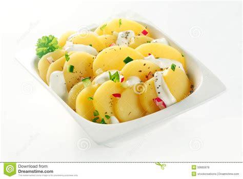 slices of design salad bowl by bosa stylepark creamed boiled german potato salad on white bowl stock