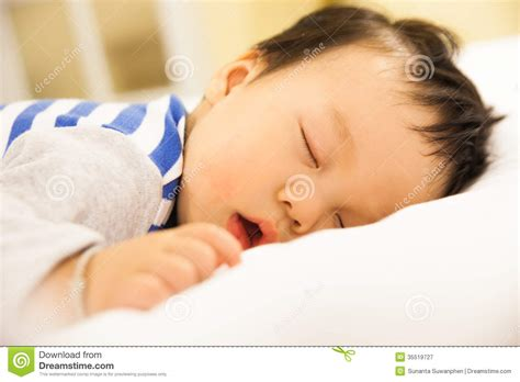 cute teenager girls sleeping stock photos and images sleeping baby boy on the bed royalty free stock
