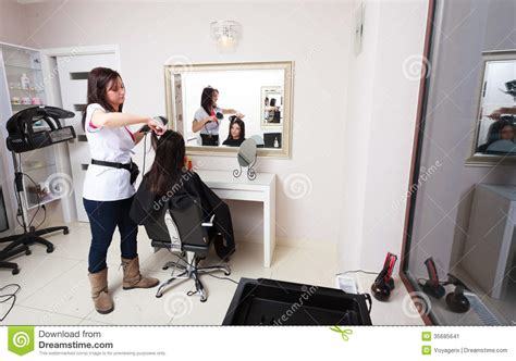 How To Be A Hair Dresser by Hairstylist Drying Hair Client In Hairdressing