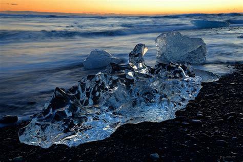 black sand game gemstones on the black sand beach of iceland just near
