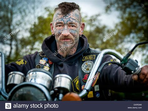 male biker with tattoos and piercings stock photo