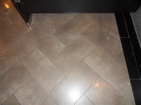 Which Direction To Lay Flooring If Brone By Carpet - bathroom on wood grain espresso cabinets and