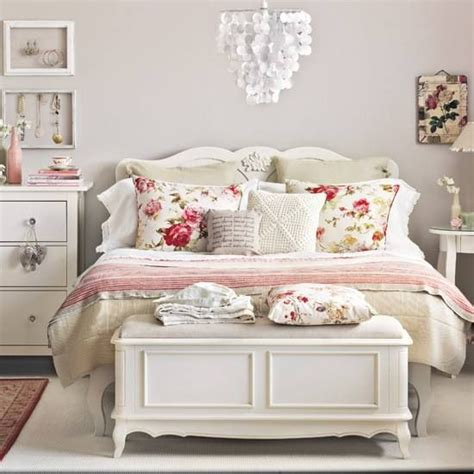 pretty bedroom it s the rose print pillows the bed layers the unmatched style yet color match