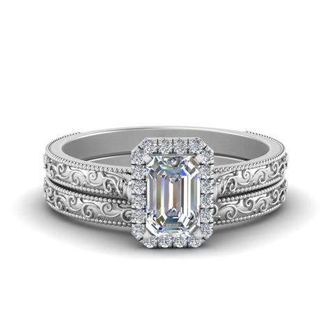 emerald cut tapered wedding ring set in white gold