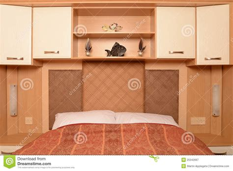 bedroom overhead storage overhead storage cabinets overhead bed with shelves and cabinets stock image image 25342667