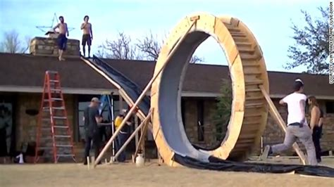 builds epic backyard sledding hill cnn