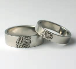 The wedding band is a fingerprint ring which is hand engraved with